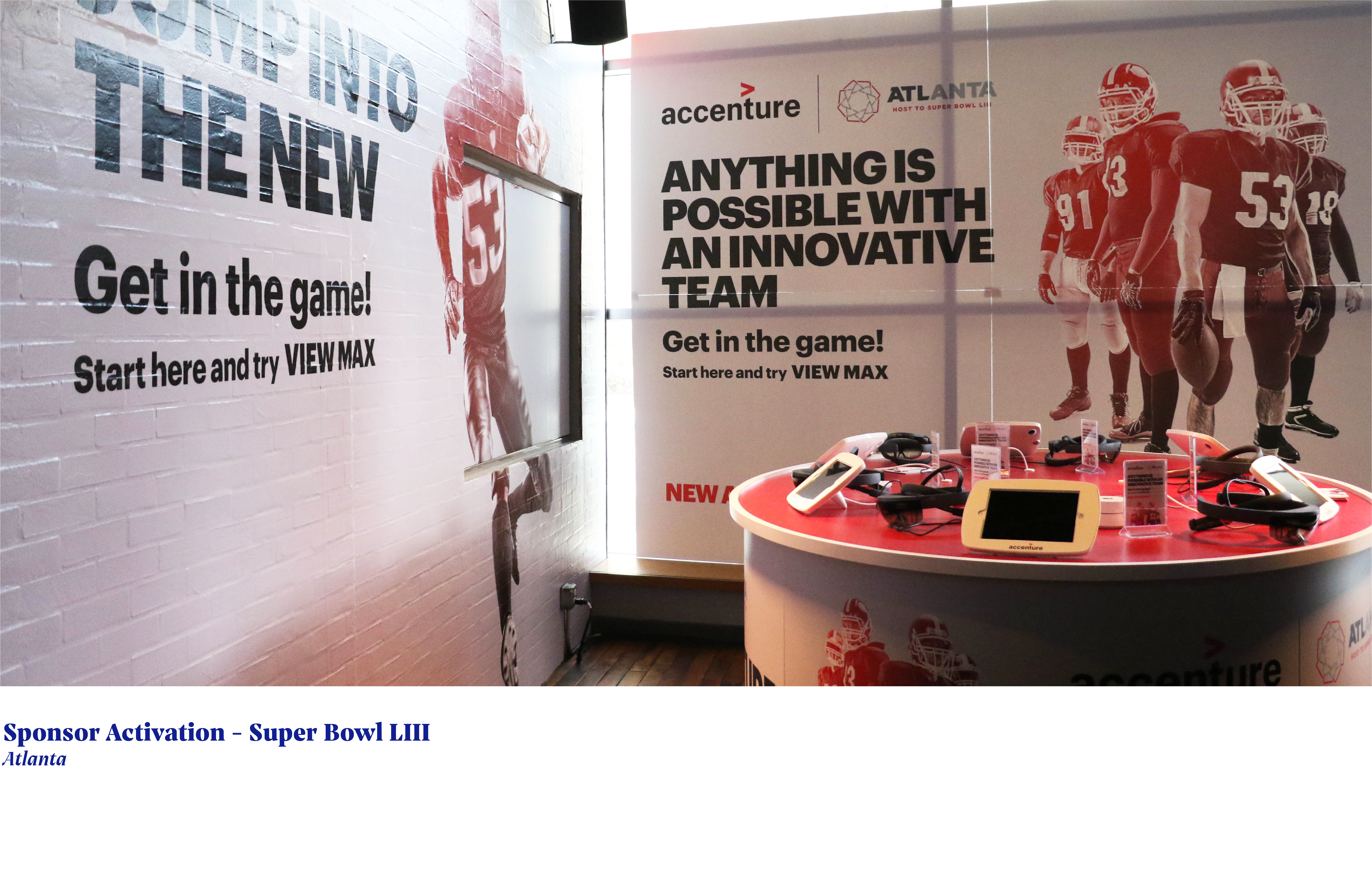 wall graphics on brick with football players and accenture advertising